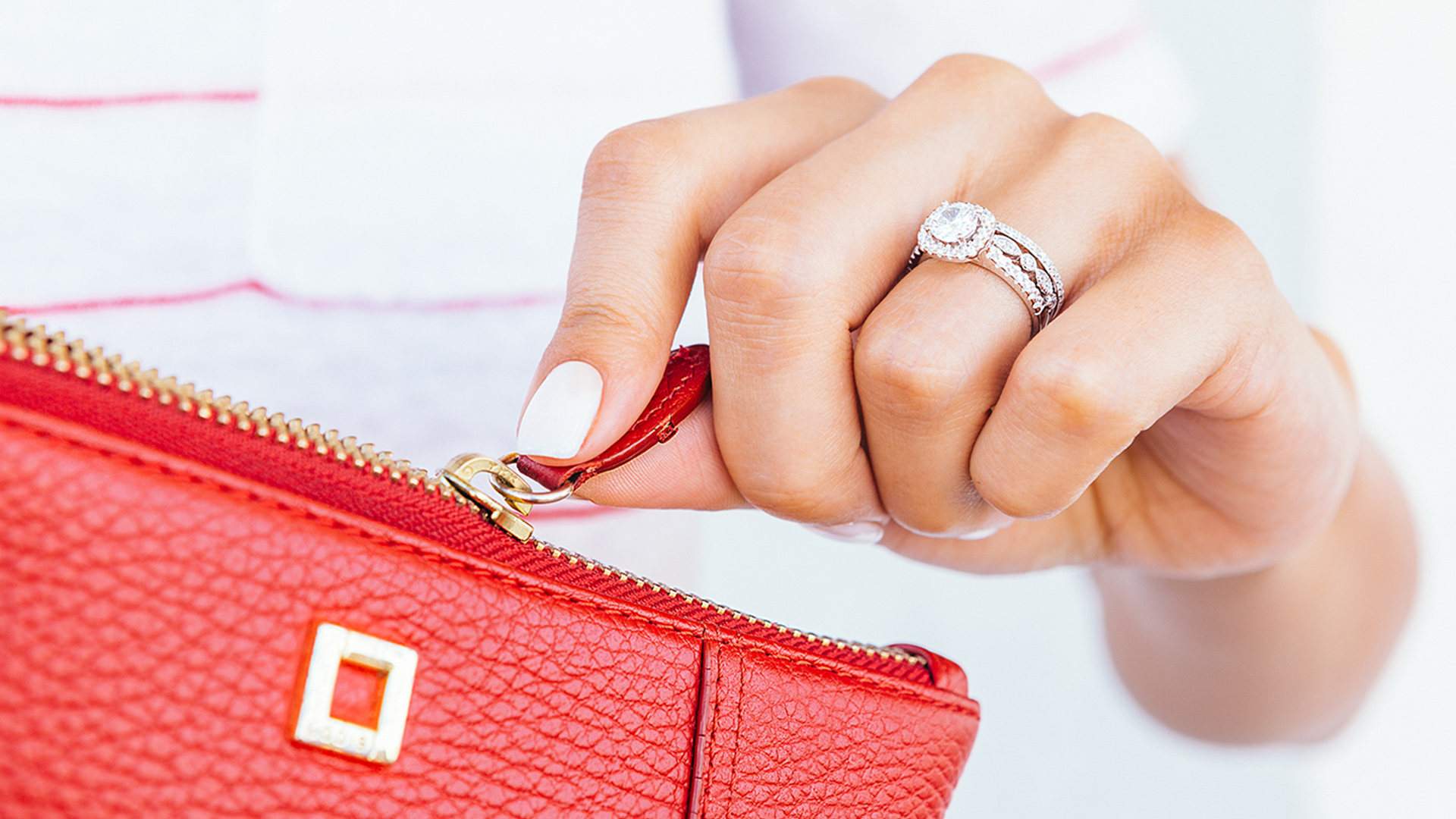 Woman wearing engagement ring and wedding bands